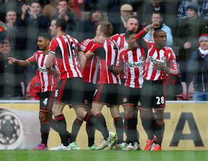 Jermain Defoe of Sunderland (R) celebrates with team mates after scoring their second goal