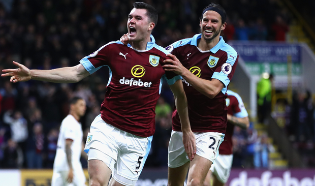 Michael Keane (left) celebrates alongside Burnley team-mate George Boyd. Picture: Getty Images
