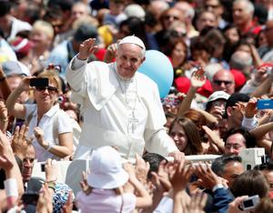Pope Francis waves at the end of a canonization mass in Saint Peter's Square