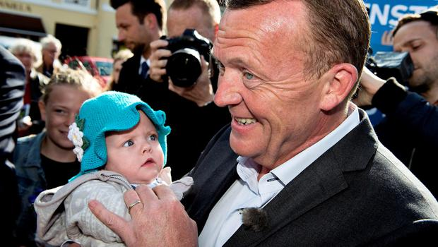 Leader of opposition party Venstre, Lars Loekke Rasmussen, carries a baby during the general election in Koege, Denmark, June 18, 2015. Denmark's election was too close to call as voting continued on Thursday, a first exit poll said, with Prime Minister Helle Thorning-Schmidt's centre-left alliance running neck-and-neck with the main opposition, led by former prime minister Rasmussen. REUTERS/Nils Meilvang/Scanpix Denmark