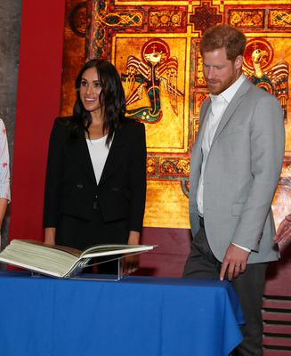 Royal visitors: Prince Harry and his wife Meghan Markle viewing the Book of Kells at Trinity College. Photo: Maxwells