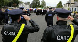 A Garda salute for Det Garda Colm Horkan as his remains are removed through the town of Charlestown Co. Mayo  Picture; Gerry Mooney