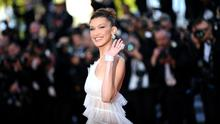 "US model Bella Hadid waves as she arrives for the screening of the film ""Rocketman"" at the 72nd edition of the Cannes Film Festival in Cannes, southern France, on May 16, 2019. (Photo by LOIC VENANCE / AFP)"