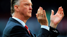 Man Utd manager Louis van Gaal applauds the fans after his side's 1-1 draw with Arsenal