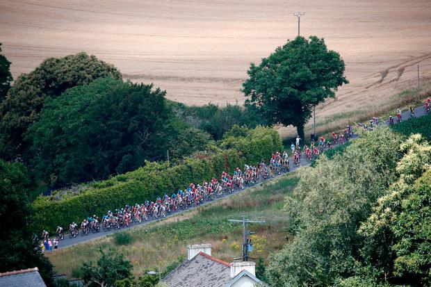 The pack pedals during the fifth stage of the Tour de France cycling race over 204.5 kilometers (127 miles) with start in Lorient and finish in Quimper, France, Wednesday, July 11, 2018. (AP Photo/Christophe Ena)