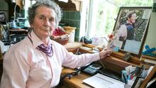 Margaret Gill at her home in Offaly with a photo of her late daughter Barbara.