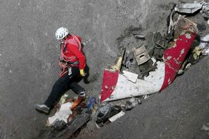 A French rescue worker inspects the remains of the Germanwings Airbus A320 at the site of the crash, near Seyne-les-Alpes, French Alps March 29, 2015. REUTERS/Gonzalo Fuentes