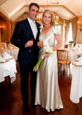 Claire Byrne with husband Gerry Scollan on their wedding day in June last year. Photo: Conor McCabe