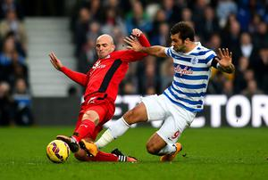 Leicester City midfielder Esteban Cambiasso battles for the ball with Charlie Austin of Queens Park Rangers during their Premier League clash at Loftus Road. Photo: Christopher Lee/Getty Images