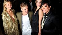 From left: Gigi Hadid, Justin Bieber, Kendall Jenner, and Kris Jenner pose for photographer at the Carine Roitfeld & Stephen Gan celebration of the launch of CR Fashion Book N.5 in Paris, Tuesday, Sept. 30, 2014.(AP Photo/Zacharie Scheurer)