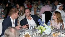 Prince Harry, Christian Horner and Geri Halliwell speak during a dinner after the Sentebale Polo Cup presented by Royal Salute World Polo at Ghantoot Polo Club on November 20, 2014 in Abu Dhabi, United Arab Emirates.