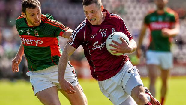 14 June 2015; Danny Cummins, Galway, in action against Keith Higgins, Mayo. Connacht GAA Football Senior Championship Semi-Final, Galway v Mayo. Pearse Stadium, Galway. Picture credit: David Maher / SPORTSFILE