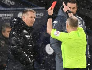 Aston Villa manager Dean Smith is shown a red card by referee Jonathan Moss. Photo: Reuters