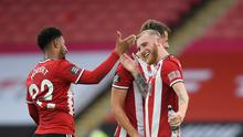 Sheffield United's Oliver McBurnie and Lys Mousset celebrate Mousset's goal in the 3-1 win over Spurs. (COVID-19) Michael Regan/Pool via REUTERS