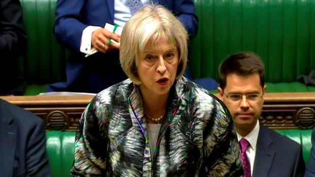 Home Secretary Theresa May responds to an urgent question on the Calais migrant crisis in the House of Commons, London.