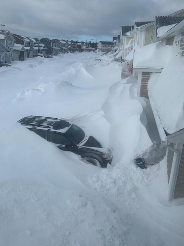 Pile of snow is pictured outside houses in St John's, Newfoundland And Labrador, Canada January 18, 2020 in this picture obtained from social media. Picture taken January 18, 2020. J. David Mitchell/via REUTERS