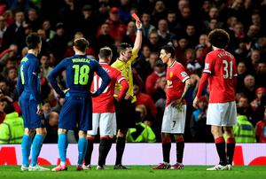 Referee Michael Oliver shows a red card to Angel di Maria after the Manchester United man tugged at the his shirt following during the FA Cup quarter-final at Old Trafford. Photo: Laurence Griffiths/Getty Images
