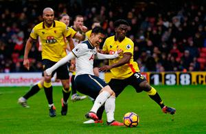 Tottenham's Son Heung-min in action with Watford's Brandon Mason. Photo: Reuters / Paul Childs