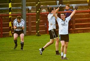 Ronan O'Neill (right) celebrates Omagh St Enda's victory over St Eunan's. Ramsey Cardy / SPORTSFILE