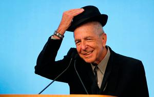 Musician Leonard Cohen tips his hat to the audience as he accepts the 2012 Awards for Song Lyrics of Literary Excellence, which was awarded to both he and Chuck Berry at the John F. Kennedy Presidential Library and Museum, in Boston, Massachusetts, U.S. on February 26, 2012.   Photo: Reuters