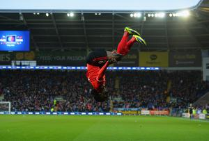 Cardiff City's new signing Kenwyne Jones celebrates with a somersault after scoring