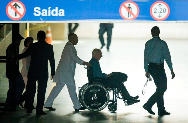 Mr Hickey leaves a hospital in Rio in a wheelchair to be taken for further questioning by police. Photo: SPORTSFILE