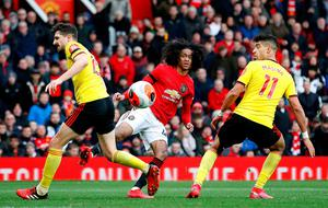 Manchester United's Tahith Chong (centre) watches his effort on goal. Photo: Martin Rickett/PA Wire