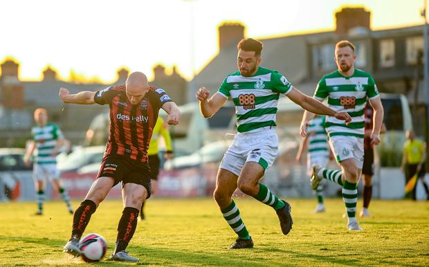 Bohemians' Georgie Kelly shoots to score despite the attention of Shamrock Rovers' Roberto Lopes