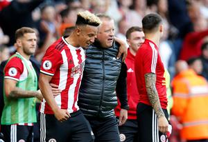 TWO HAPPY: Sheffield United manager Chris Wilder celebrates with Ireland's Callum Robinson. Pic: Reuters