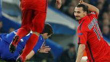 PSG's Zlatan Ibrahimovic, right, reacts after having fouled Chelsea's Oscar during their Champions League round of 16 second leg soccer match between Chelsea and Paris Saint Germain at Stamford Bridge