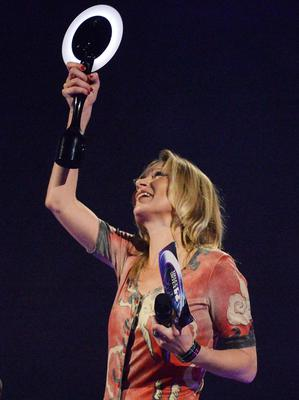 Model Kate Moss accepts the British Male Solo Artist award on behalf of David Bowie. Reuters