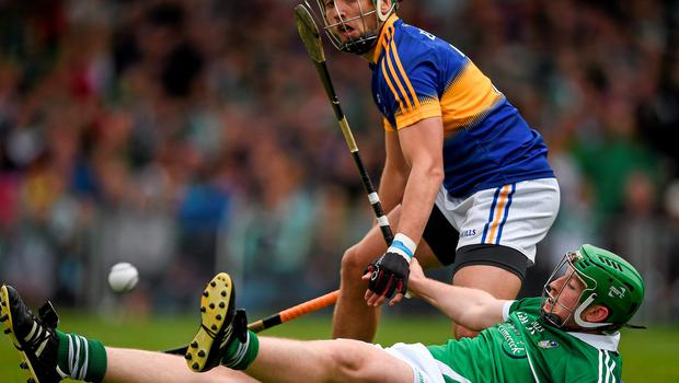Limerick's Shane Dowling goes to ground under pressure from James Barry