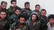 This picture released on Sunday, May 24, 2015, by a militant website which had been verified and is consistent with other AP reporting shows Syrian government soldiers who were captured by Islamic state militants in Palmyra area in Syria. (Militant website via AP)