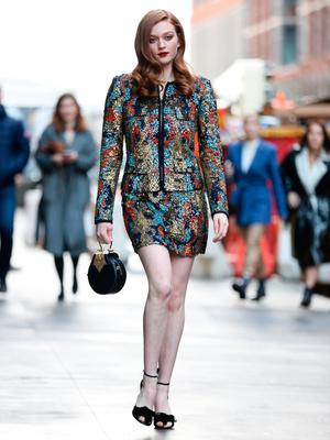 Larsen Thompson is seen wearing a multi colored blue, red and gold dress and black heels outside of the Naeem Khan show during New York Fashion Week on February 11, 2020 in New York City. (Photo by Donell Woodson/Getty Images)