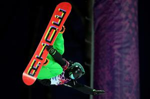 Ireland's Seamus O'Connor performs a jump during the men's snowboard halfpipe semi-final event at the 2014 Sochi Winter Olympic Games, in Rosa Khutor February 11, 2014