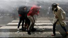 Firing line: Nepalese youths brave a water cannon during a protest near the prime minister's official residence, demanding a better response from the government to fight the coronavirus. Photo: REUTERS/Navesh Chitrakar