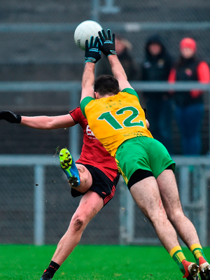 Paul Devlin of Down has a shot blocked by Caolan McGonigle of Donegal. Photo by Oliver McVeigh/Sportsfile