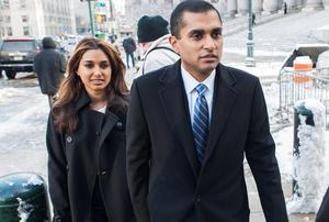 Former SAC Capital Advisors portfolio manager Mathew Martoma (R) arrives with his wife Rosemary at the Manhattan Federal Courthouse on February 4, 2014.