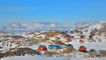 Colourful: Greenland offers stunning views, but it will take you 33 hours and three stopovers to get there.
