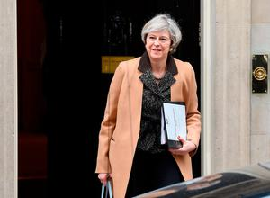 British Prime Minister Theresa May leaves 10 Downing Street in London ahead of a statement to MPs on last week's European Council meeting