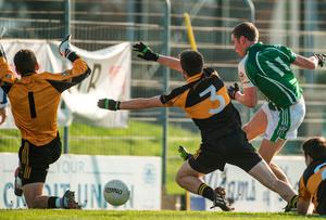 Patrick Kelly, Ballincollig, shoots to score his side's first goal past Fearghal MacNamara and Austin Stacks goalkeeper Darragh O'Brien. Picture credit: Diarmuid Greene / SPORTSFILE