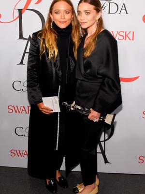 NEW YORK, NY - JUNE 01:  Mary-Kate Olsen and Ashley Olsen pose on the winners walk at the 2015 CFDA Fashion Awards at Alice Tully Hall at Lincoln Center on June 1, 2015 in New York City.  (Photo by Larry Busacca/Getty Images)