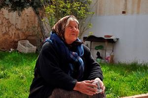 An Assyrian woman, that fled the unrest in Hasakeh's Tal Tamer district, rests at a house where she has taken refuge in the northeastern city of Qamishl. Photo: AFP/Getty Images