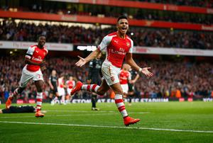 Alexis Sanchez celebrates after opening the scoring for Arsenal in their Premier League win over Burnley at the Emirates. Photo: Julian Finney/Getty Images