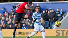 Manchester United's Radamel Falcao (L) takes a shot at goal but misses during their English Premier League soccer match against Queens Park Rangers