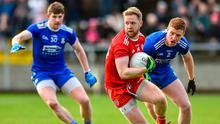 Frank Burns of Tyrone in action against Kieran Duffy of Monaghan