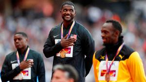 Justin Gatlin of the U.S. celebrates his gold with silver medalist Christian Coleman of the U.S. (L) and bronze medalist Usain Bolt of Jamaica (R). REUTERS/Matthew Childs