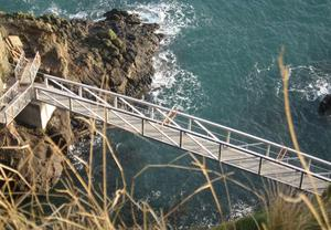 The Gobbins, a series of bridges, staircases, caves and tunnels carved through the rock at Islandmagee. It opens this summer.