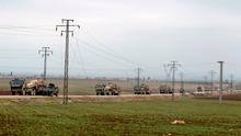 Turkish military vehicles drive in the Syrian rebel-held town of al-Rai, as they head towards the northern Syrian town of al-Bab, Syria January 4, 2017. REUTERS/Khalil Ashawi
