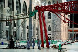 Civil Defense personnel inspect the damage at the Grand Mosque after a crane collapsed, in Mecca, Saudi Arabia, early Saturday morning, Sept. 12, 2015. The towering construction crane toppled over on Friday during a violent rainstorm in the Saudi city of Mecca, Islam's holiest site, crashing into the Grand Mosque, ahead of the start of the annual hajj pilgrimage later this month. (AP Photo)